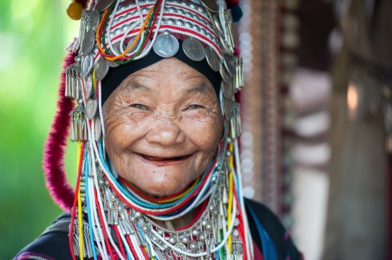 06 05 770 Chiang Rai Unidentified Akha tribe elderly woman with traditional clothes and silver jewelery shutterstock 166331657