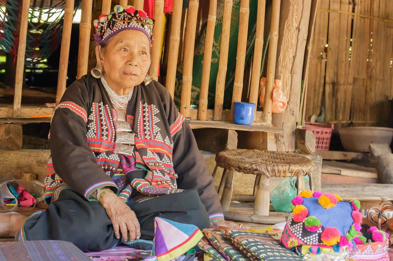 770 Sensationell Nord traditional of thai old woman selling souvenirs at Chiangmai shutterstock 531098482